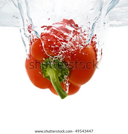 fresh Red Bell Pepper splashing into water