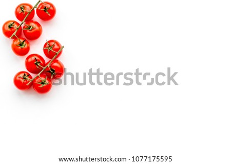 Fresh red cherry tomatoes scattered on white background top view copy space #1077175595