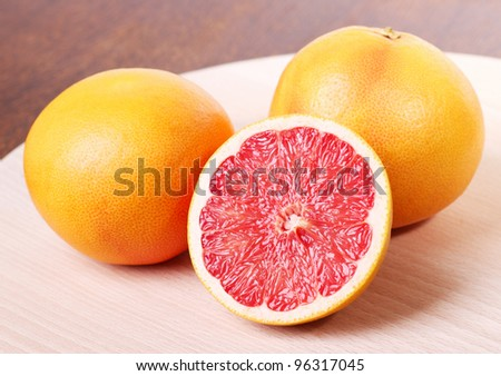 Fresh Red Grapefruit on Cutting Board