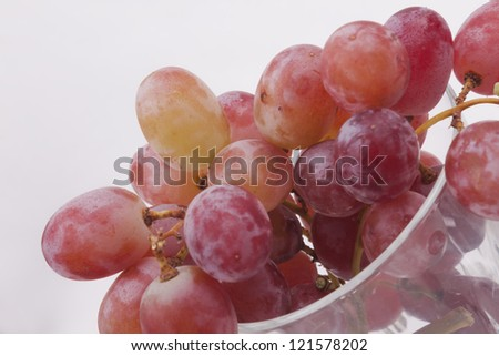 Fresh red grapes on white background