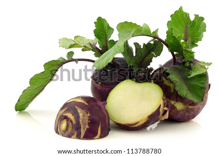 fresh red kohlrabi (Brassica oleracea) and a cut one on a white background