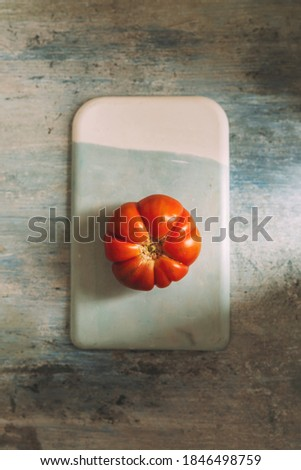 Fresh red Marmande RAF red tomatoes, on celestial and white stone table Zdjęcia stock ©