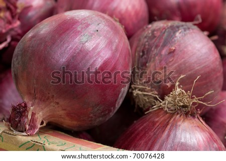Fresh red onions from a vegetable market.