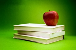 Fresh red organic apple on a top of books