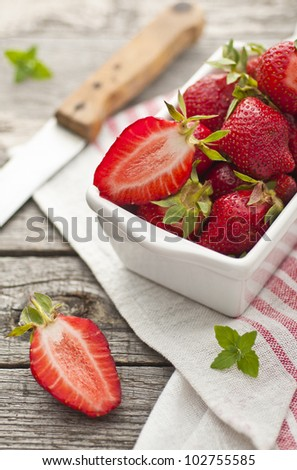 Fresh red strawberries in a dish