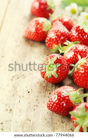 fresh red strawberries on wooden table top