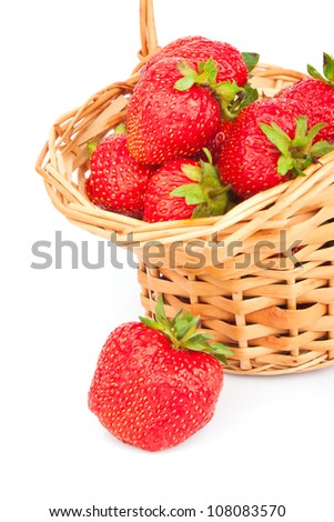 Fresh red strawberry in wicker basket isolated on white background