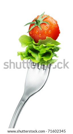 fresh red tomato and salad on a fork Isolated