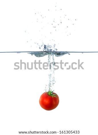 Fresh Red Tomato Fruit Sinking in Water Isolated on White Background
