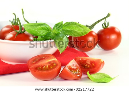 fresh red tomatoes in a white bowl