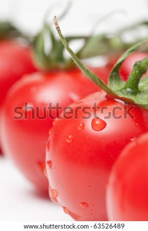 fresh red tomatoes on white background
