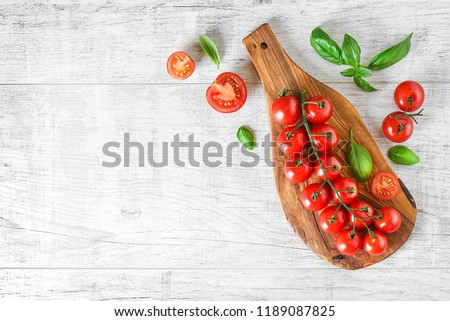 Fresh red tomatoes on white background or light rustic table. Tomato variety vegetable concept space for text or banner top view #1189087825
