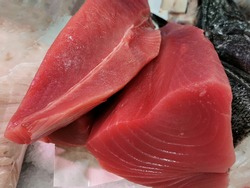 fresh red tuna loin at market