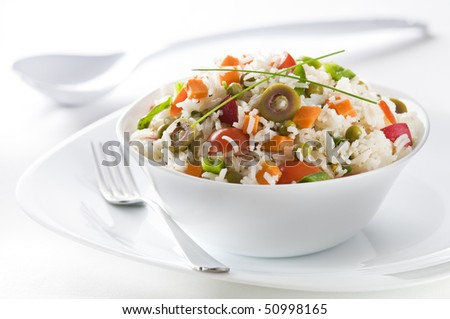 Fresh rice salad in a bowl close up shoot