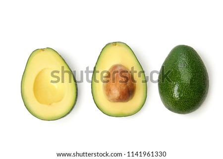 Fresh ripe avocados on white background