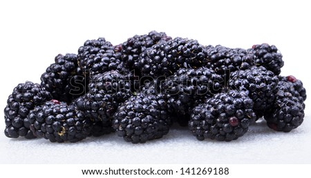 Fresh Ripe Blackberries with water drops macro background