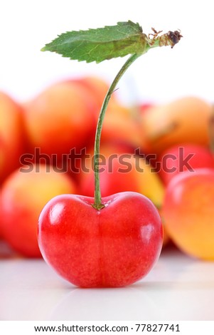 Fresh ripe cherries isolated on white background