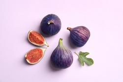Fresh ripe figs on light background, top view