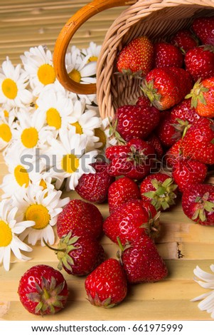 Fresh ripe juicy strawberries on a silver saucer #661975999