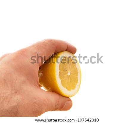 fresh ripe lemon cutted in half hold in hand closedup