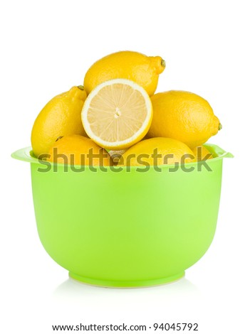 Fresh ripe lemons in a bowl. Isolated on white background