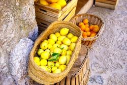 Fresh ripe lemons on a market in old village. Spain