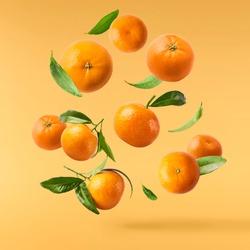 Fresh ripe mandarine on white background.