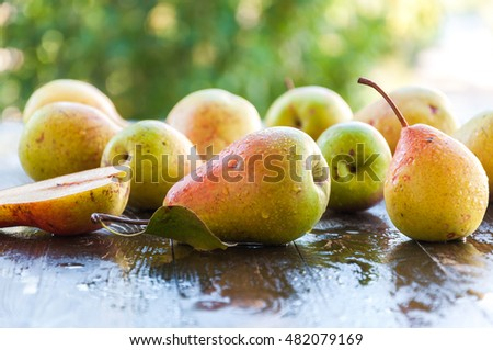 Fresh ripe organic pears on rustic wooden table, natural background, vega, diet food