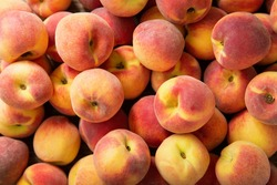 fresh ripe peaches as background, top view