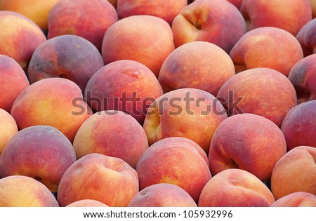 fresh ripe peaches in the box ready for sale