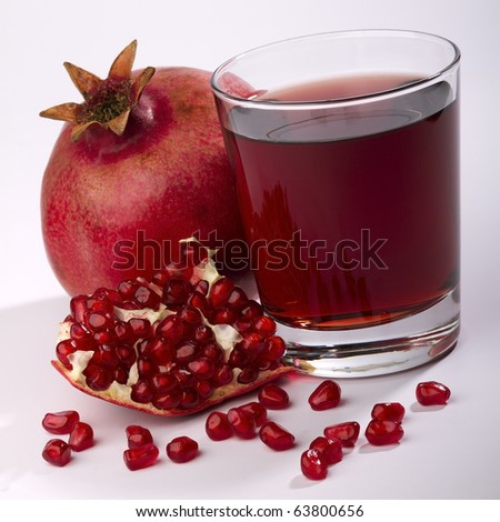 fresh ripe pomegranate and juice in the glass