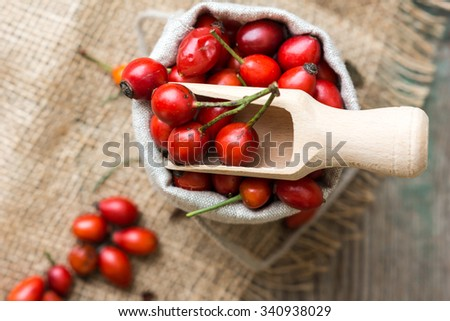 Fresh ripe rose hips in burlap bag on the rustic background Stock photo ©