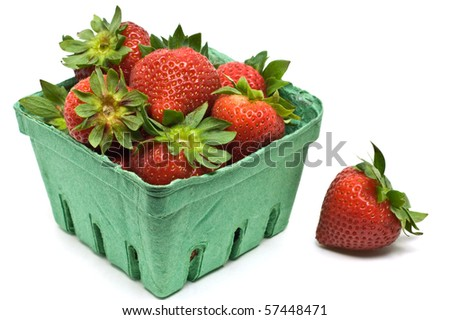 Fresh ripe strawberries in green cardboard container isolated on white background in horizontal format