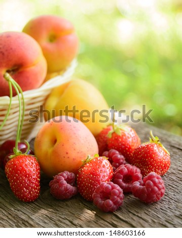 Fresh Ripe Sweet Fruits on the Wooden Table in the Garden. Fresh Organic Food - stock photo