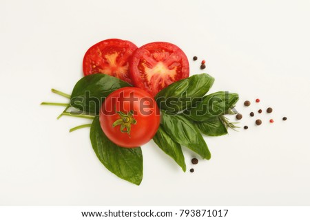 Fresh ripe tomatoes, juicy green basil leaves and black pepper isolated on white background. Healthy natural organic food, harvest and italian cooking concept #793871017