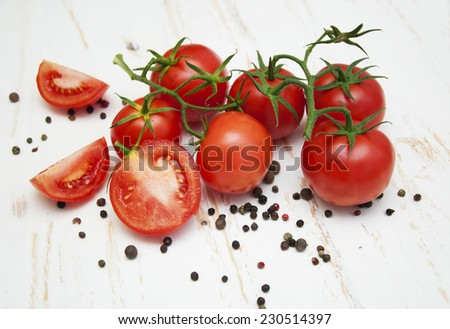 Fresh ripe tomatoes on a white wooden background #230514397