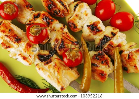 fresh roast chicken shish kebab on green platter