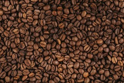Fresh roasted coffee beans texture.