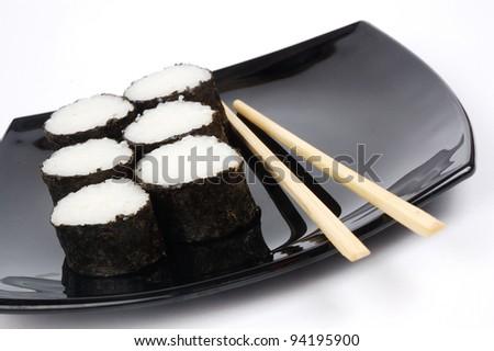 fresh rolls on a black dish