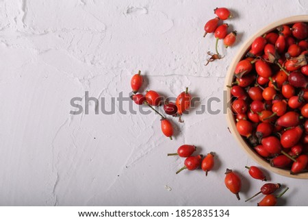 fresh rosehip fruits are on the table Stock photo ©