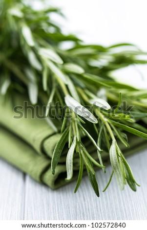 Fresh Rosemary on Tea Towel - stock photo