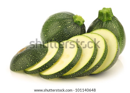 fresh Round Zucchini's and a cut one on a white background