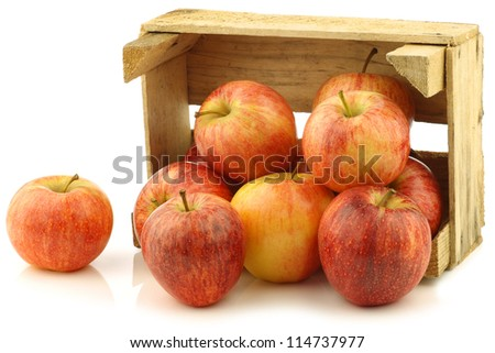 "fresh ""royal gala"" apples in a wooden crate on a white background"