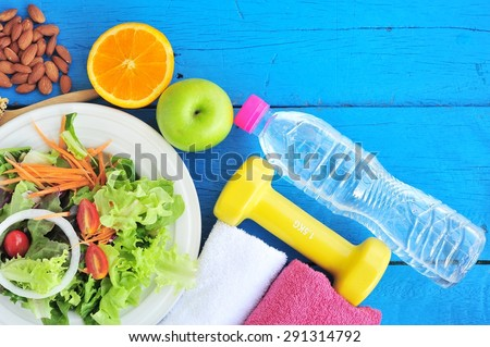 Fresh salad, fruits with sport and diet concept.