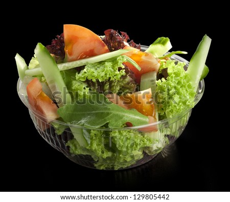 fresh salad of fresh vegetables on a black background