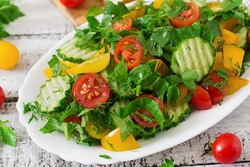 Fresh salad of tomatoes, cucumbers, peppers, arugula and dill