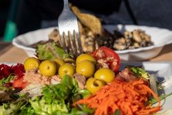 Fresh salad on table in restaurant Valencia Spain Mediterranean diet