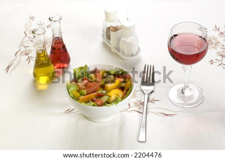 fresh salad on the table with wine oil and vinegar