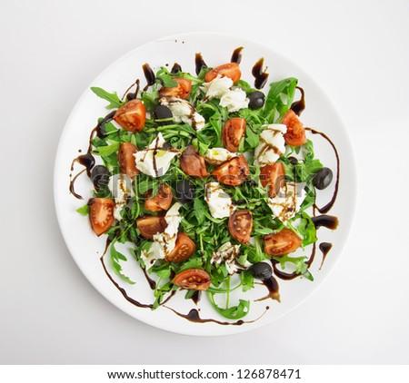 fresh salad, rucola, mozzarella, tomatos,olives, balsamic vinegar