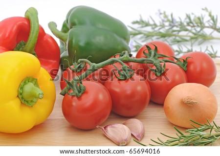 Fresh Salad Vegetables on wood surface.